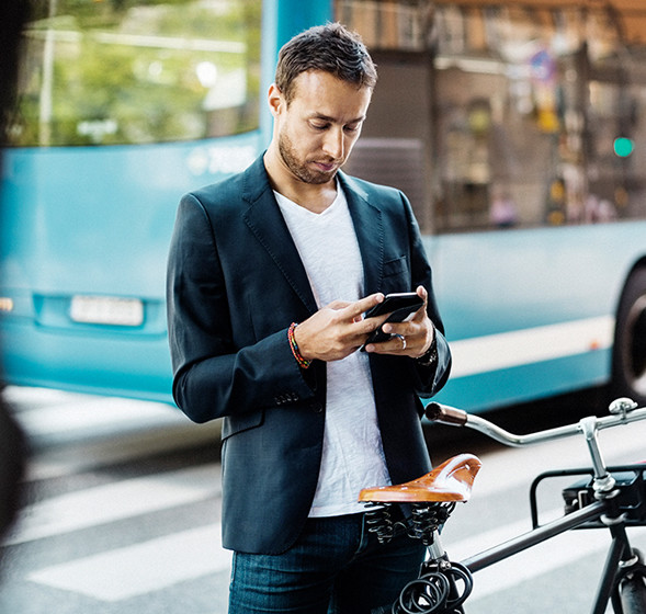Man reading accounting figures on mobile